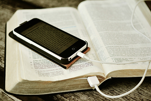 Image of Bible and Iphone for Contact Us Page